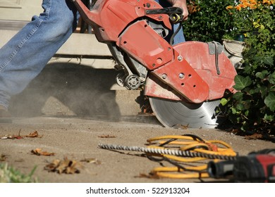 Man Cutting with Concrete Saw