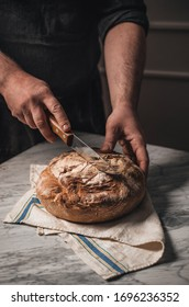 Man cutting homemade organic bread