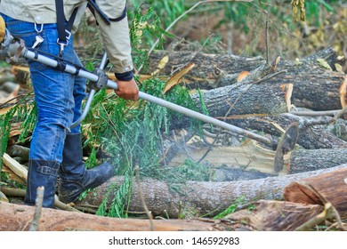 Man cutting piece of wood Cutting wood