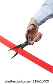 A man cutting a scarlet ribbon with scissors, isolated on white
