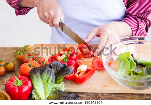 Man cutting vegetables for healthy salad, selective focus
