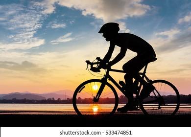 Man cycling at the beach twilight time summer season