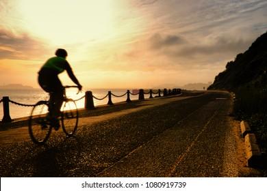 Man cycling at Golden Gate National Recreation Area, The Presidio, San Francisco, California, USA