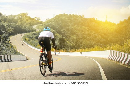 Man cycling mountain road bike in the morning