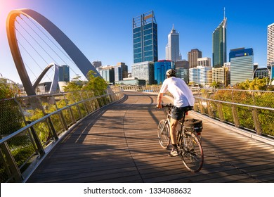 A man cycling on an elizabeth bridge in Perth city, western, Austrakia, this image can use for bike, sport, relax, healthy concept