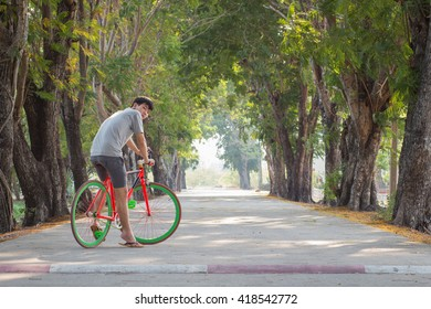 Man cycling in the shade