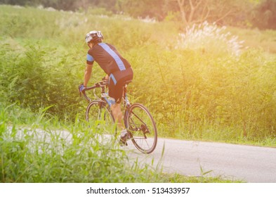 A man cyclist riding the bicycle