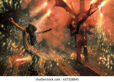 Man dance into the sparks of the devils festival