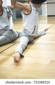 Man dancer dance  teacher stetching in gym fitness studio doing advanced bar stretch flexibility posture.