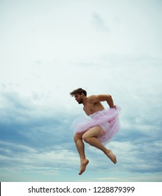 Man dancing in tutu in ballet studio. Crazy ballerina. drag queen. Man in ballerina skirt outdoor. Funny man freak. Inspiration and dreaming. sense of freedom. Man jump on sky background
