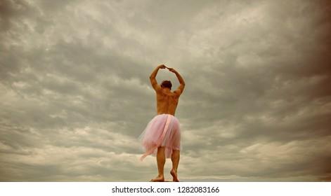 Man dancing in tutu at ballet studio. Funny man freak. Man in ballerina skirt outdoor. Inspiration dreaming. Crazy ballerina. drag queen. Enjoying his favorite music. fun in motion. dancing in sky.