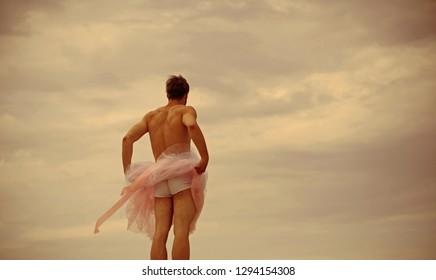 Man dancing in tutu in ballet studio, copy space. Funny man freak. Crazy ballerina. drag queen. Man in ballerina skirt outdoor. Inspiration and dreaming. playing hard. showing butt. i am a freak