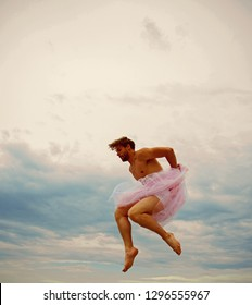 Man dancing in tutu in ballet studio. Crazy ballerina. drag queen. Man in ballerina skirt outdoor. Funny man freak. Inspiration and dreaming. sense of freedom. Man jump on sky background
