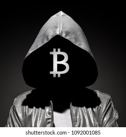 Man with dark face in the hood with bitcoin logo