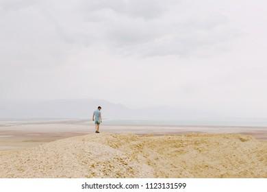 Man in the Dead Sea landscape. Travel concept
