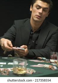Man dealing playing cards at poker game