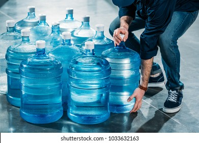 Man delivering large bottles with drinking water