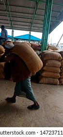 a man is delivering wheat sack at wholesale godown district Katni Madhya Pradesh in India shot captured on Aug 2019