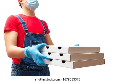 Man from delivery service in red t-shirt, in protective mask and gloves giving food order and holding three pizza boxes isolated over white background
