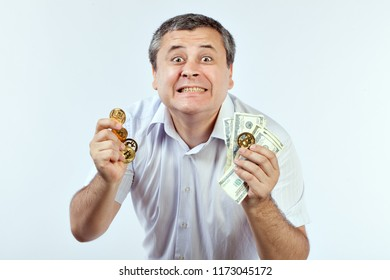 Man demonstrates bitcoins and dollars, he likes crypto currency.