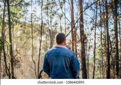 Man in denim jacket in the bush