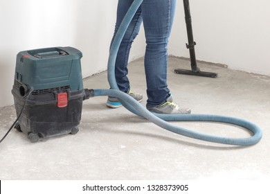 man in denim pants. makes cleaning of production rooms. apartment after repair using polysosa