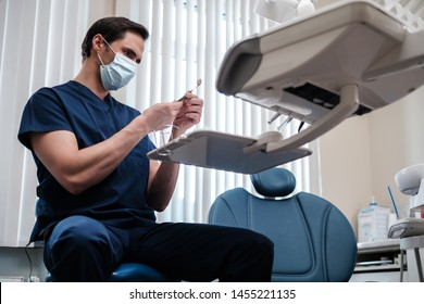 Man dentist working in private practice