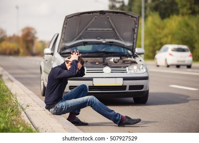 Man in despair because of the failure of his car