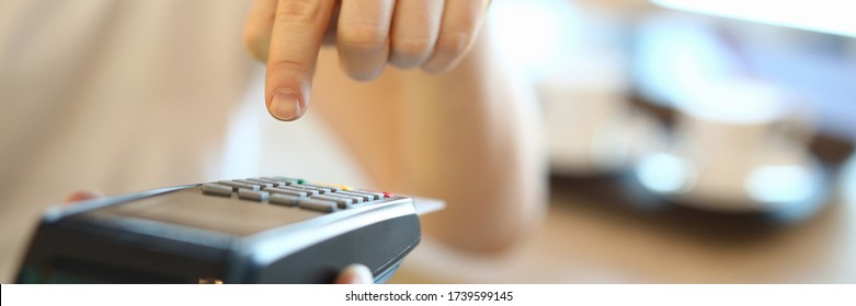 Man dials a PIN code at terminal, payment by card. Selection an effective acquiring offer. Payment by card of goods and services. Connect merchant acquiring. Portable terminal delivered to house