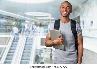 Man with digital laptop on the background.