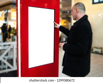 A man with Digital media blank black and white screen modern panel, signboard for advertisement design in a shopping centre, gallery. Mockup, mock-up, mock up with blurred background, digital kiosk.
