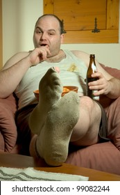 man in dirty clothes with chips and beer
