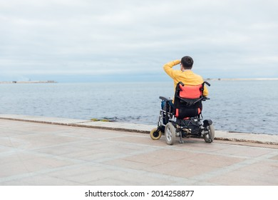 a man with disabilities in a wheelchair enjoys life