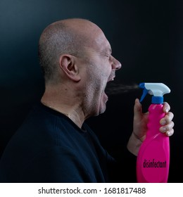 a man disinfects his mouth with a spray bottle