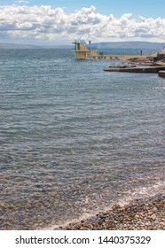 Man dives from Blackrock Diving platform in Salthill, Galway, Ireland on a sunny summer's day.