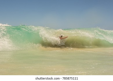 A man dives into a big wave at Swanbourne Beach in Perth, Western Australia.