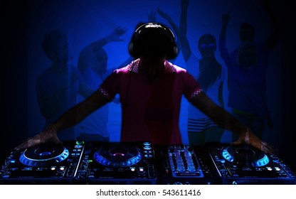 Man dj play in nightclub.