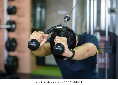 A man do a resistance training with rope and cable,Training triceps