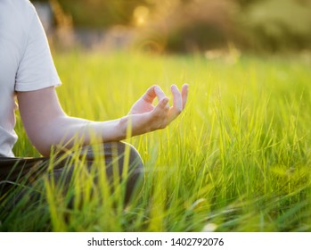 Man do yoga outdoor in the park. Healthy and Yoga Concept