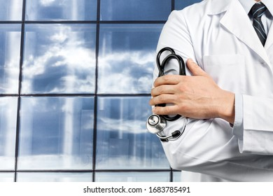 Man doctor with a black stethoscope on the window background