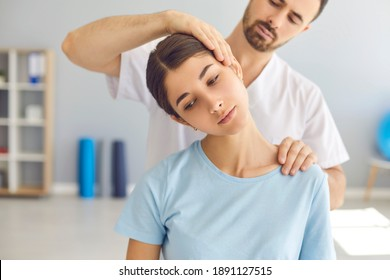 Man doctor chiropractor or osteopath setting womans neck joints with hands during visit and treatment in manual therapy clinic interior. Professional chiropractor during work concept