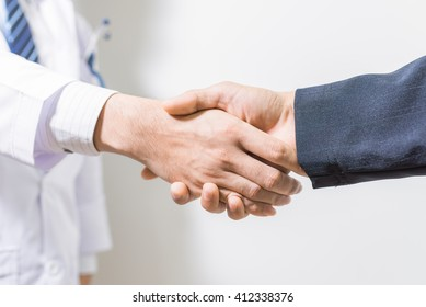 Man doctor and her lawyer shaking hands on white. handshake Business and doctor concept. Shake hands.
