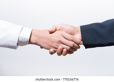 Man doctor and her lawyer shaking hands on white.