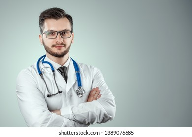 A man, a doctor in a white coat with a stethoscope. The concept of medicine, a doctor's appointment, health care. Copy space.