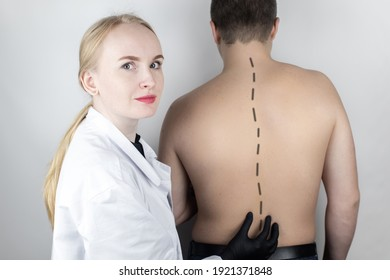 A man at the doctor's appointment with back pain. Treatment of spinal deformity and stoop. Osteoporosis, kyphosis, lordosis, or scoliosis.