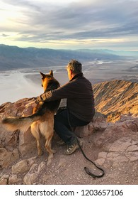 Man and dog. Badwater basin seen from Dante's view, Death Valley National Park, California, USA