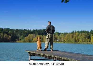 man with a dog on the catwalk
