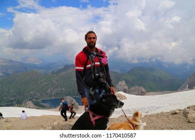 Man with dog on Punta Rocca, Marmolada