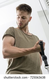Man doing bicep curl with cable pulley machine