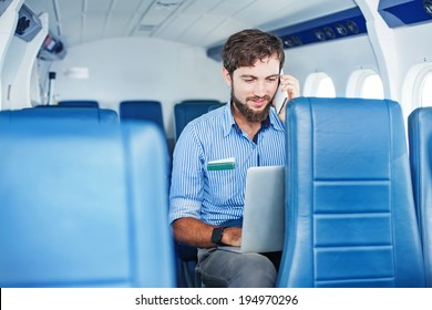 Man doing business in the airplane